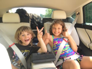 Muze and the kids in the back of the BMW