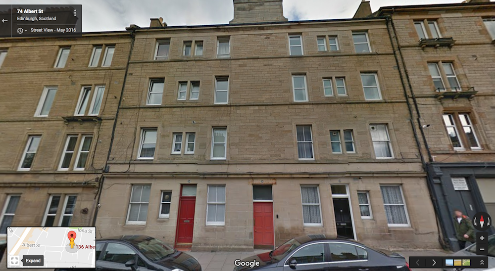 The front door is the faded red one here on Albert Street