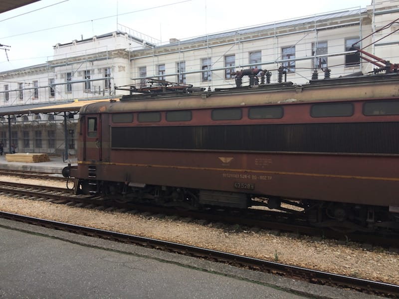 An old train passes by at the Plovdiv train station