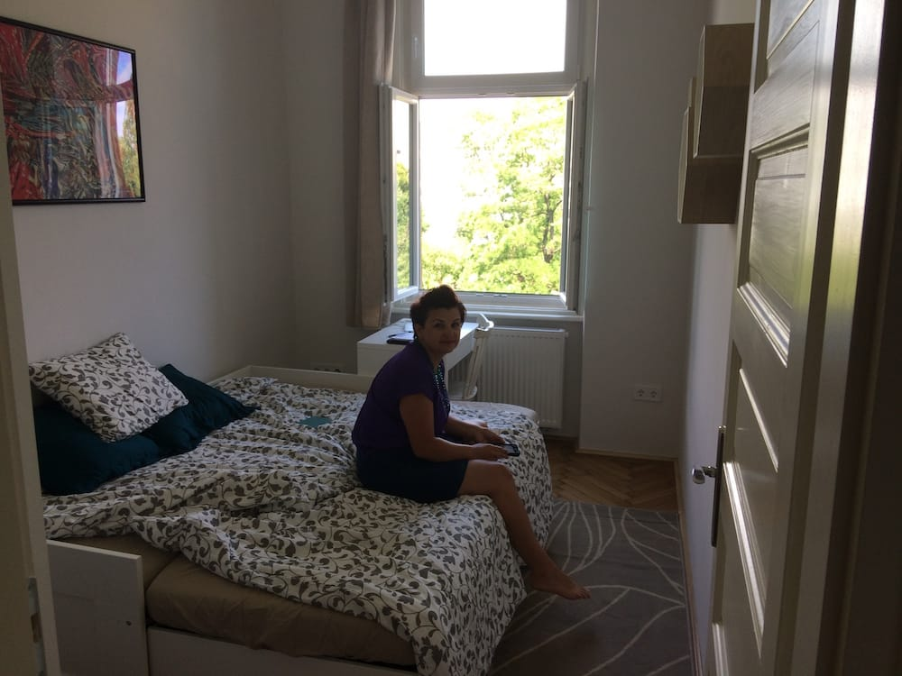 Alice in our bedroom, look at the huge windows!
