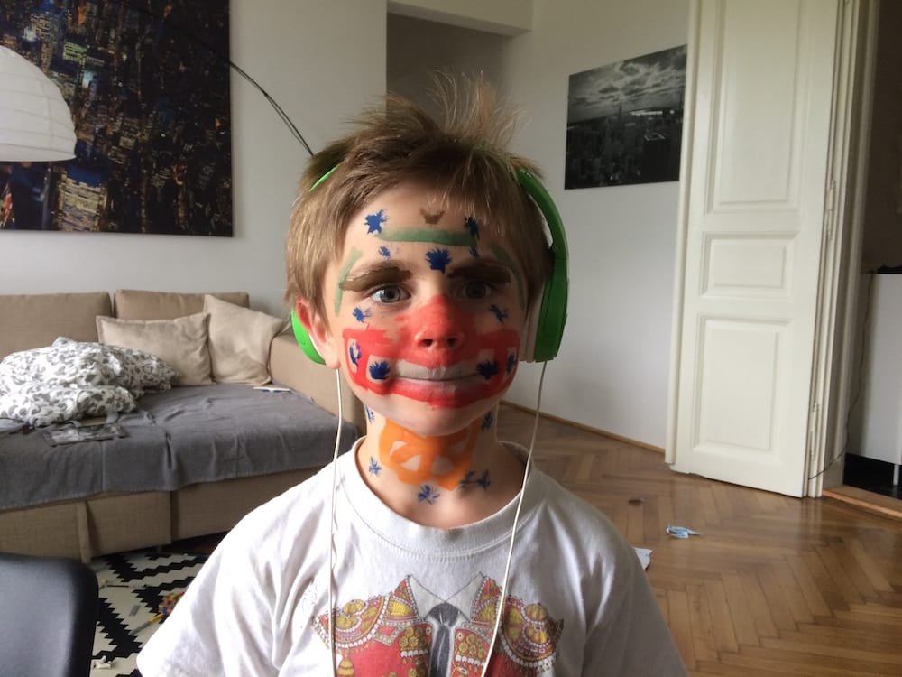 Mr.7 with homemade facepaint in the living room of the Budapest apartment