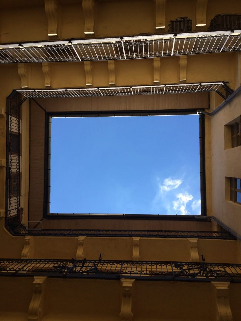 The view looking up from the courtyard at our apartment building
