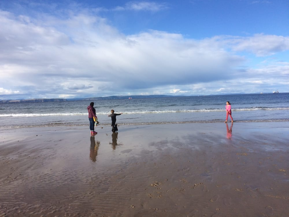 Getting wet and cold at Nairn Beach