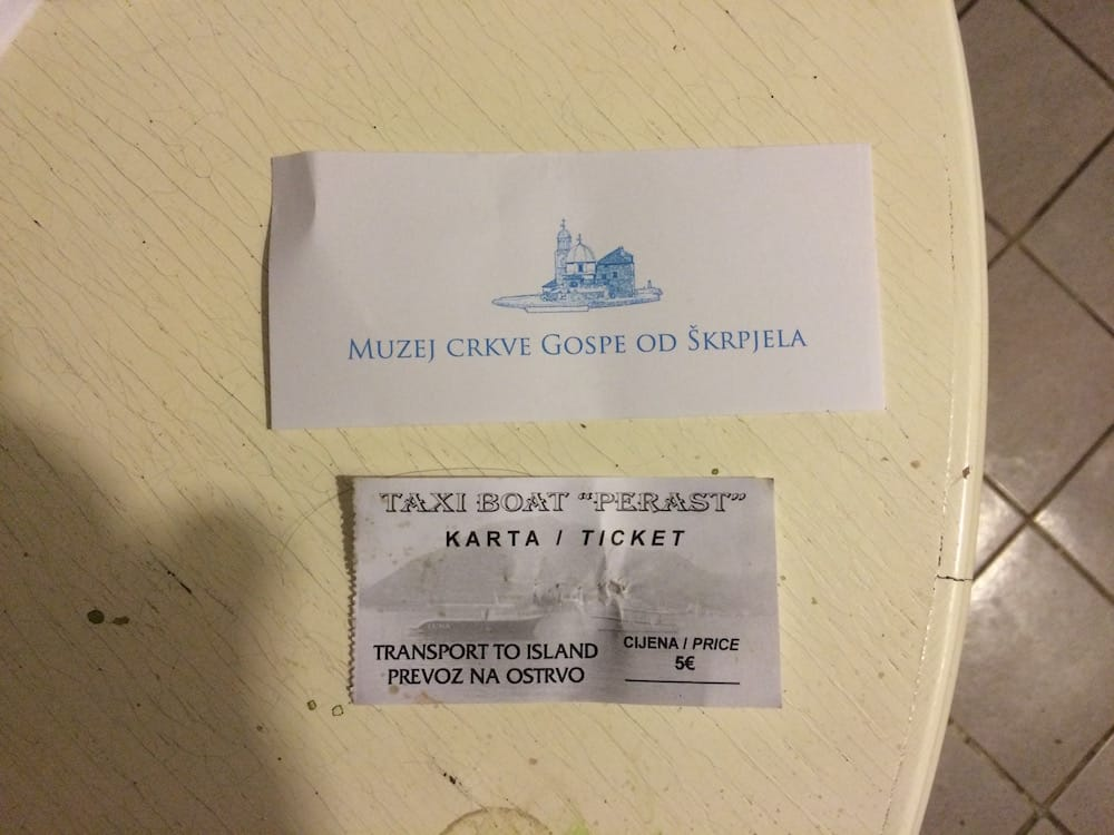 The tickets for The Church of Our Lady of the Rocks and the boat taxi to get there