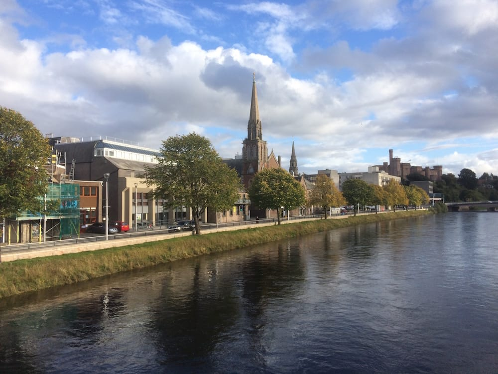 The River Ness at Inverness, looking southwest from the Ness Pedestrian Bridge and the Ness Bank Church in view