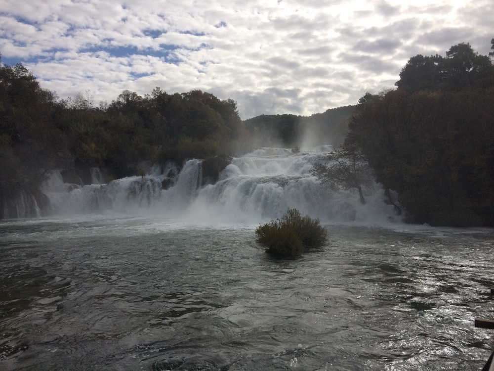 Our first glimpse of the Krka Falls, a fine mist spread in front of us, cool and crisp