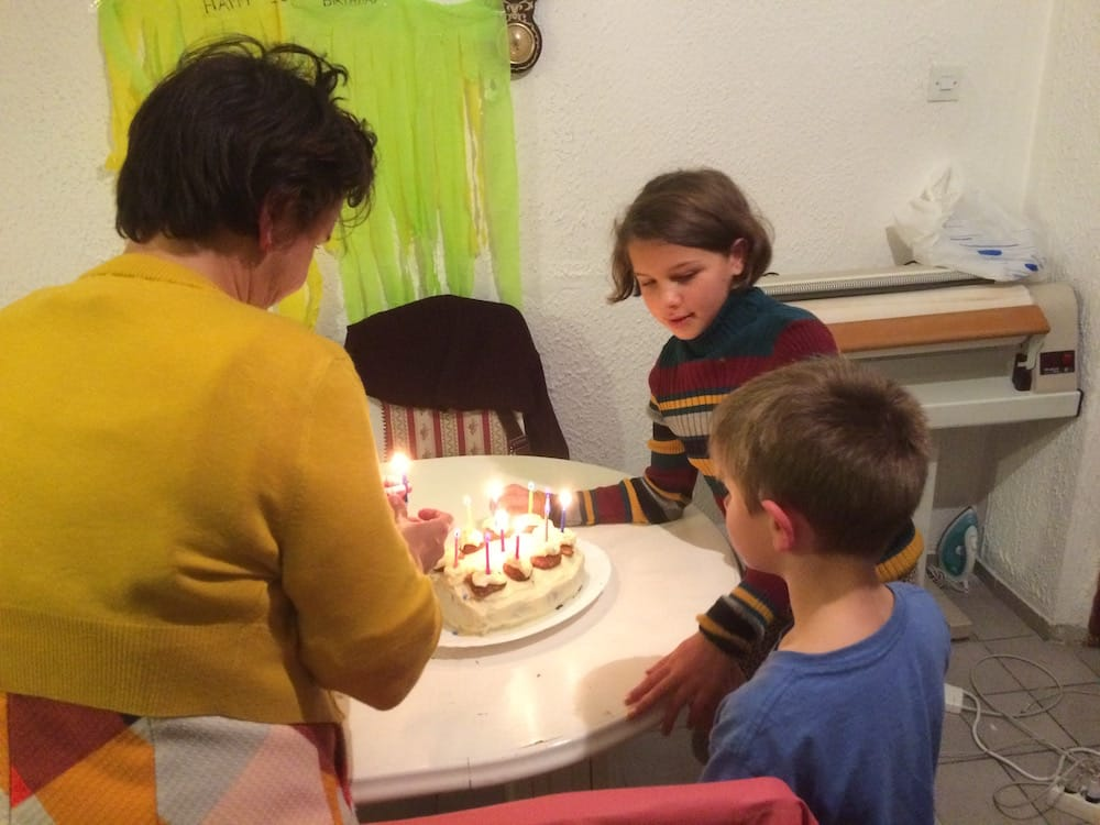 Daughter gets ready to blow out the candles