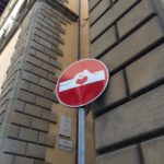 Clet street sign art, make a heart with your hands