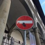 Clet street sign art, a sneaky cat sets a trap for a mouse