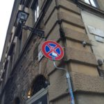 Clet street sign art, a smiling skull