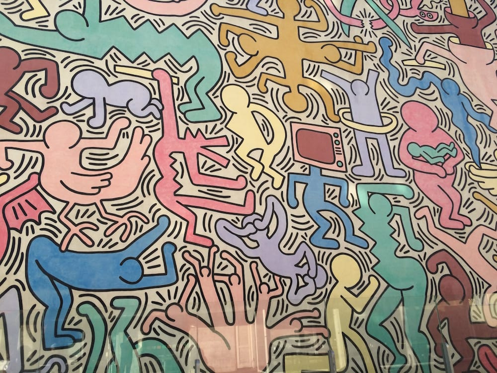 This Keith Haring work, 1989, is on a church a short distance from the train station, make sure you see it
