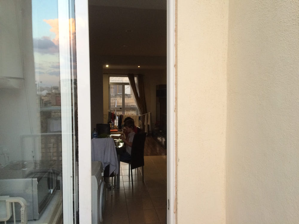 The view of the kitchen in our Malta place from the balcony