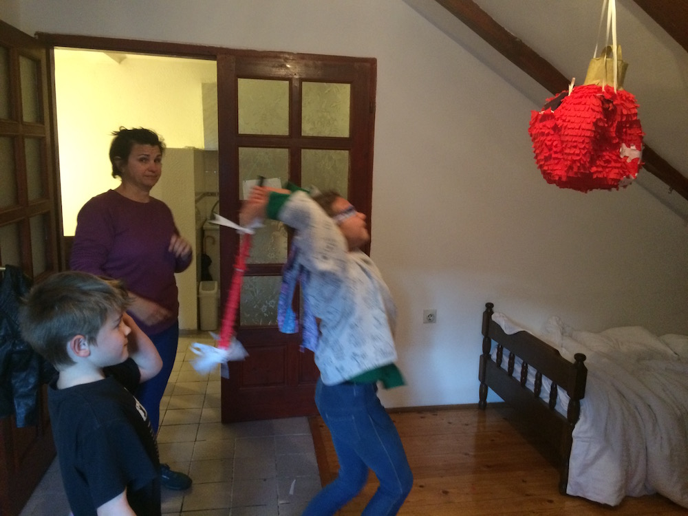 Daughter getting ready for another bash on the piñata, the swing